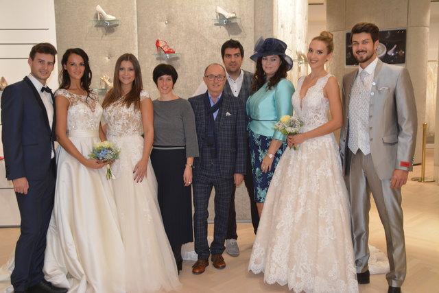 Julia Geosics (4.v.li.) und Stefan Balaskovics (Mi.) präsentierten wunderschöne Hochzeitsmode als Höhepunkt der Modenschau.